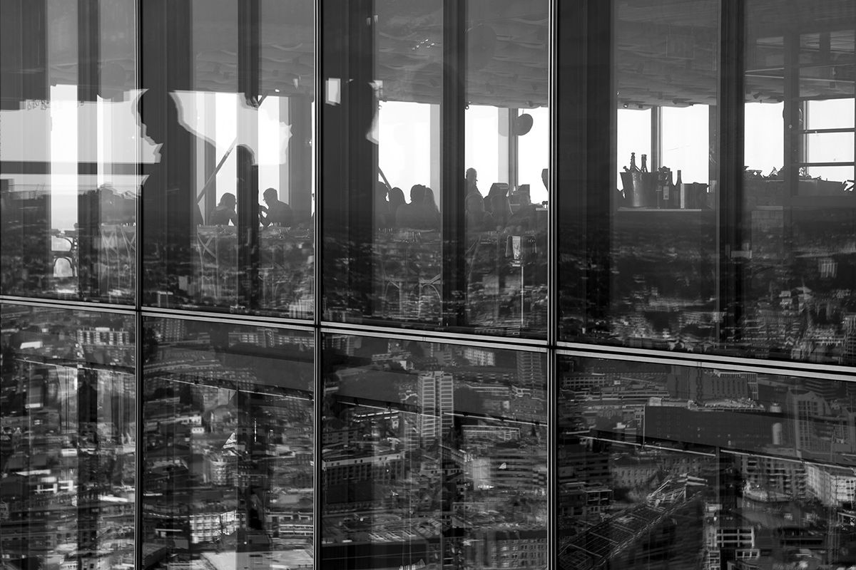 Black and white elevated view of reflections at Heron Tower, London, United Kingdom.