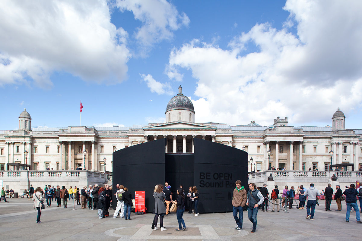 A daytime exterior view of the Sound Portal art installation in Trafalgar Square, London, United Kingdom.