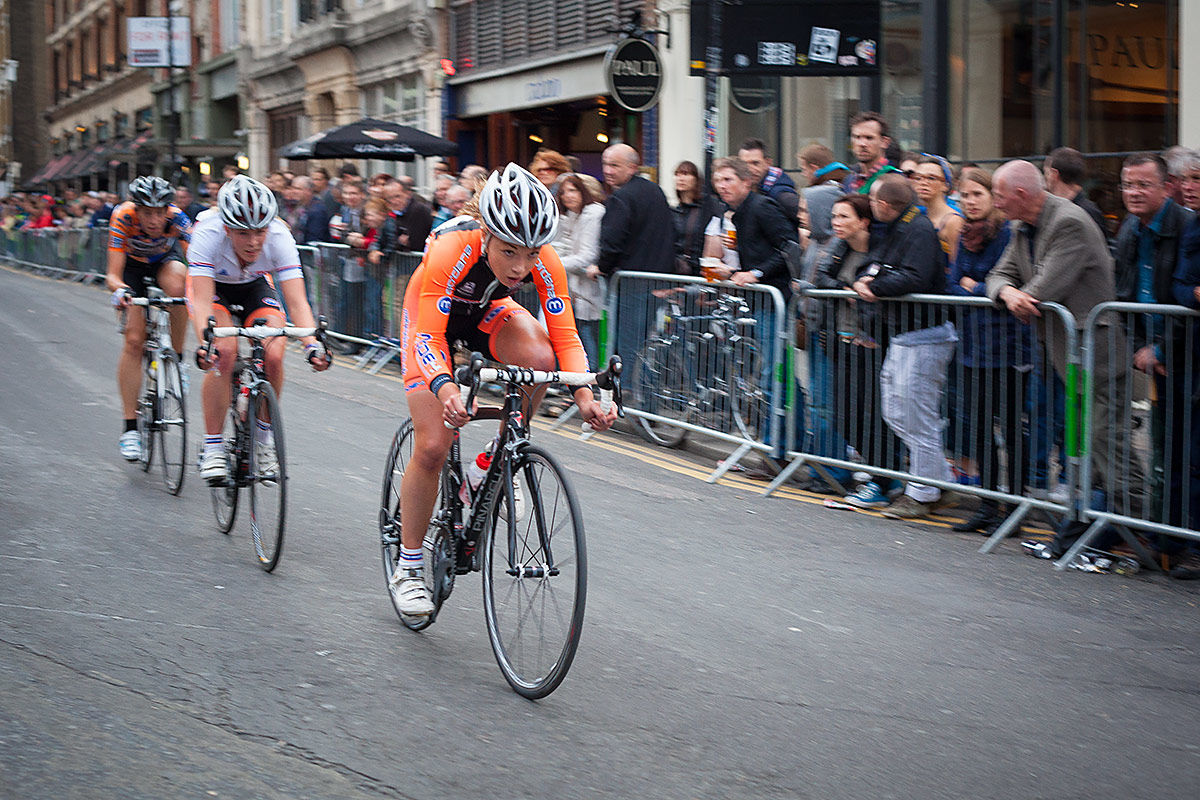 Cyclists speeding by at the London Nocturne cycling event.