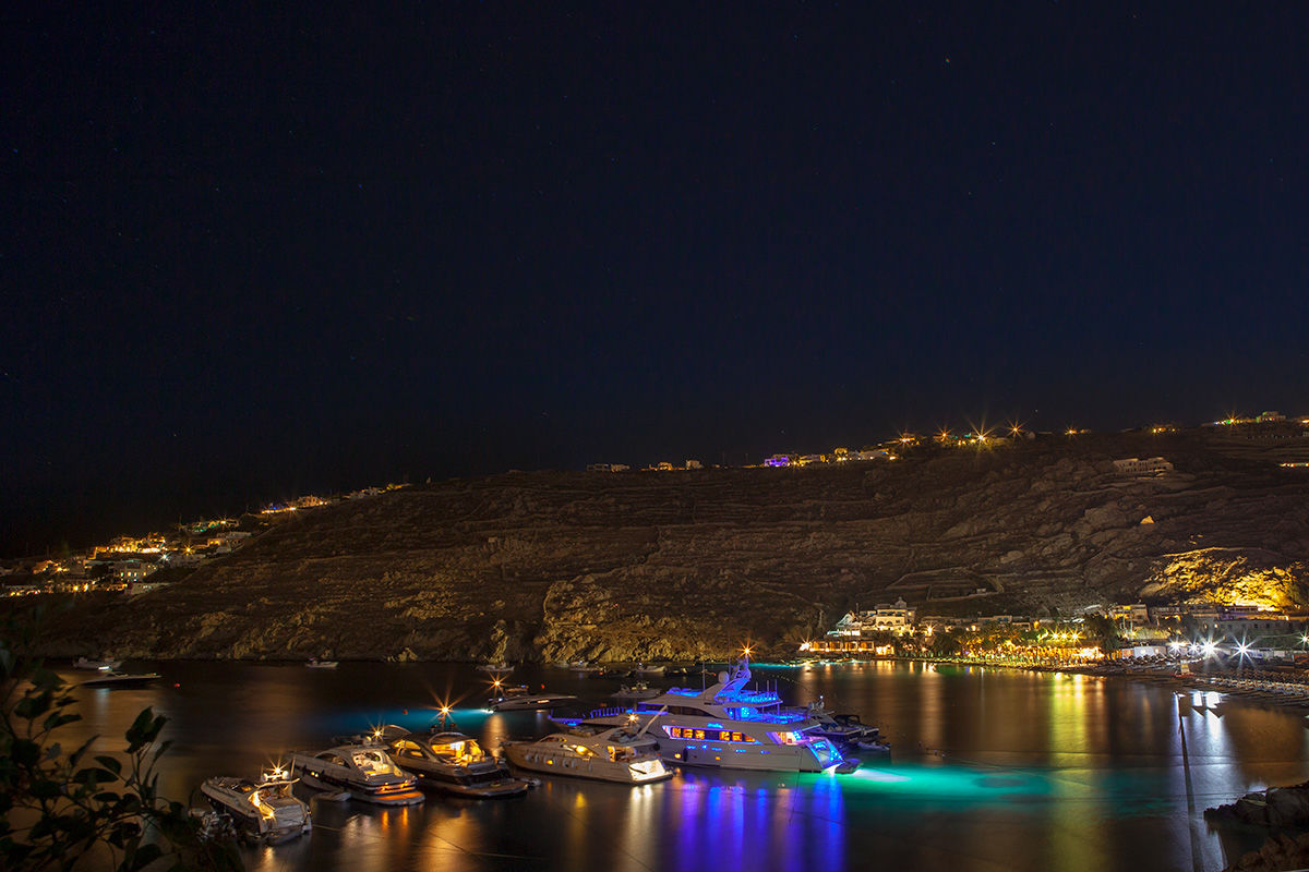 Dusk view of Psarou Beach, Mykonos, Greece.