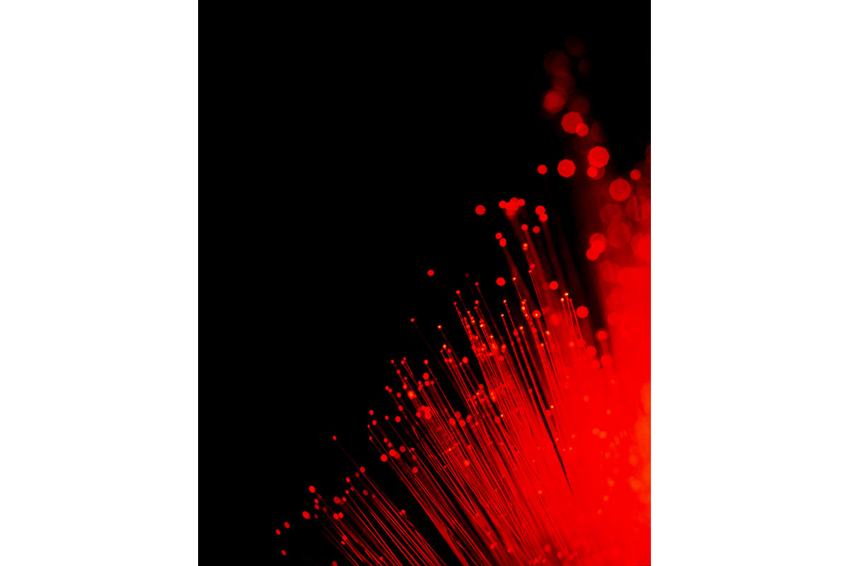 Fibre optics lit red with shallow depth of field.