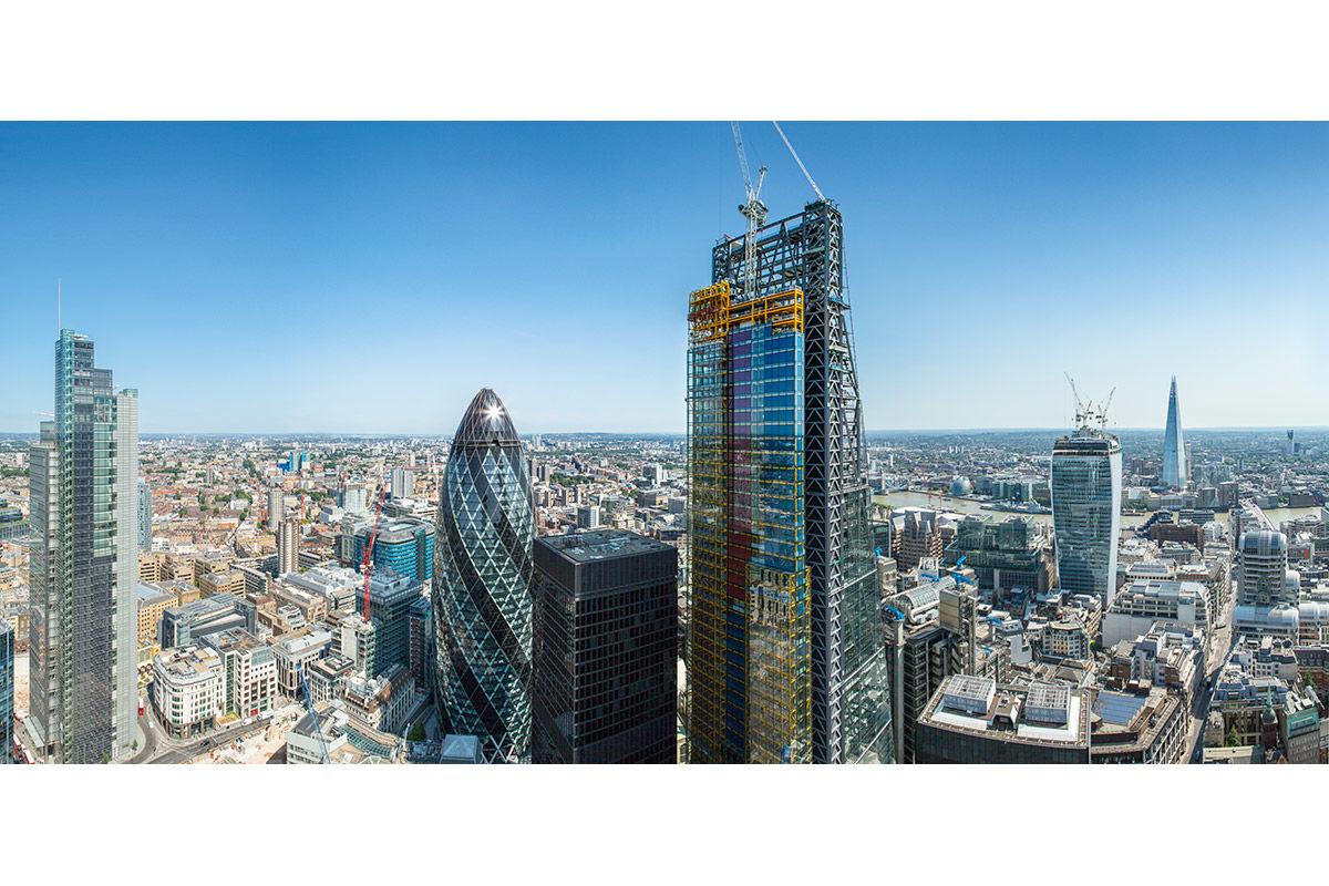 Sunny high-up view of 22 Leadenhall Street under construction, London, United Kingdom.