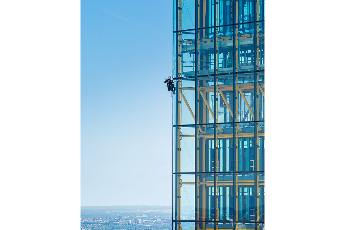High up view of 22 Leadenhall Street construction worker, London, United Kingdom.